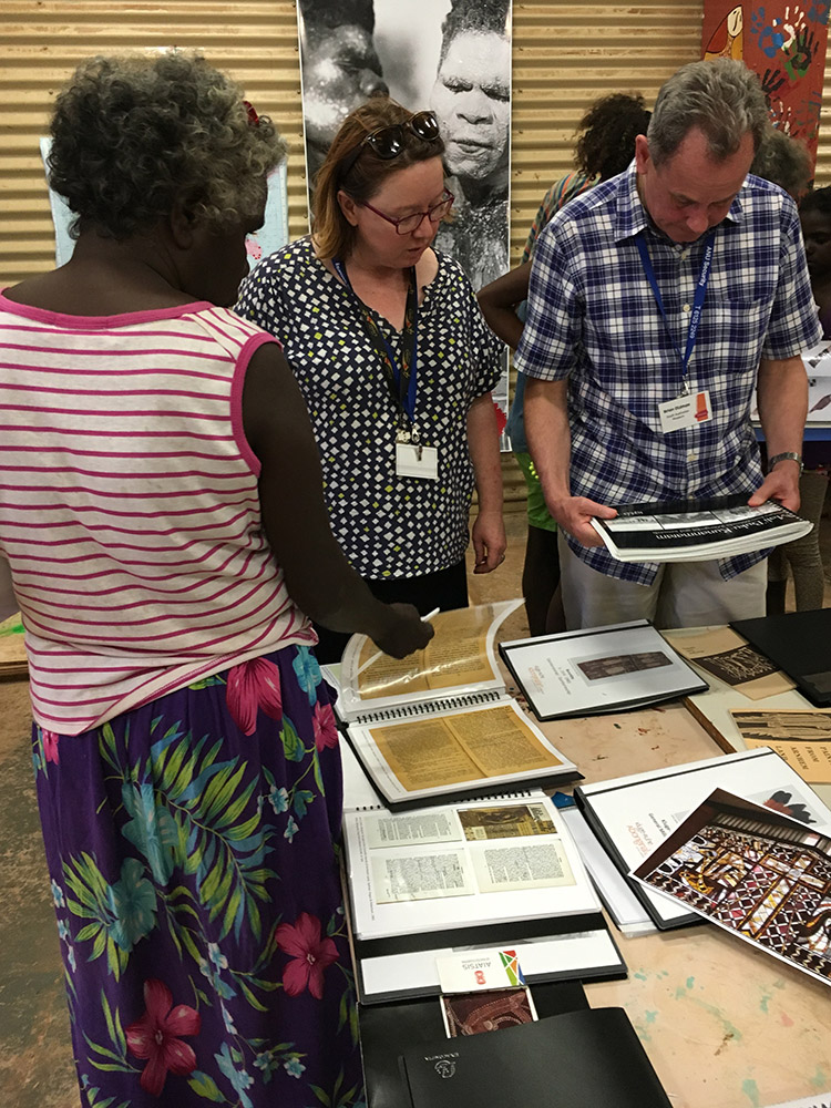 Members of the Milingimbi community and representatives from other museums browsed archival material from the Kluge-Ruhe Collection. (Photo courtesy of Margo Smith)