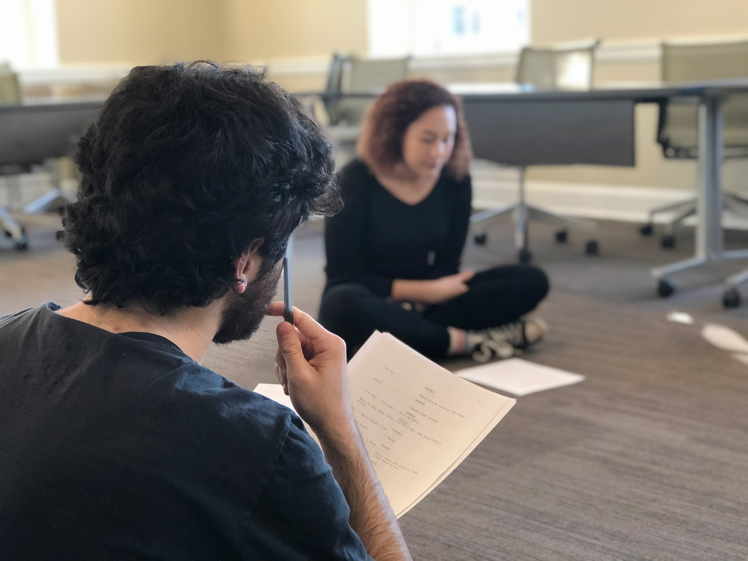 Student actors Nat Berelovich and Grace George rehearse their play, directed by JaRhonda Roberts. (Photo by Payton Moledor, University Communications)