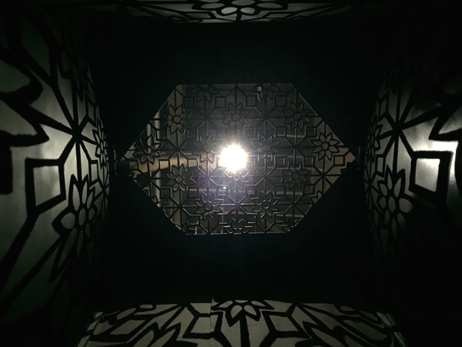 Feraidon's installation features a steel enclosure with cutout patterns that reference traditional Islamic art. The shape of the cutout also mimics small openings in traditional burqas, from which women get their only glimpse of the outside world.