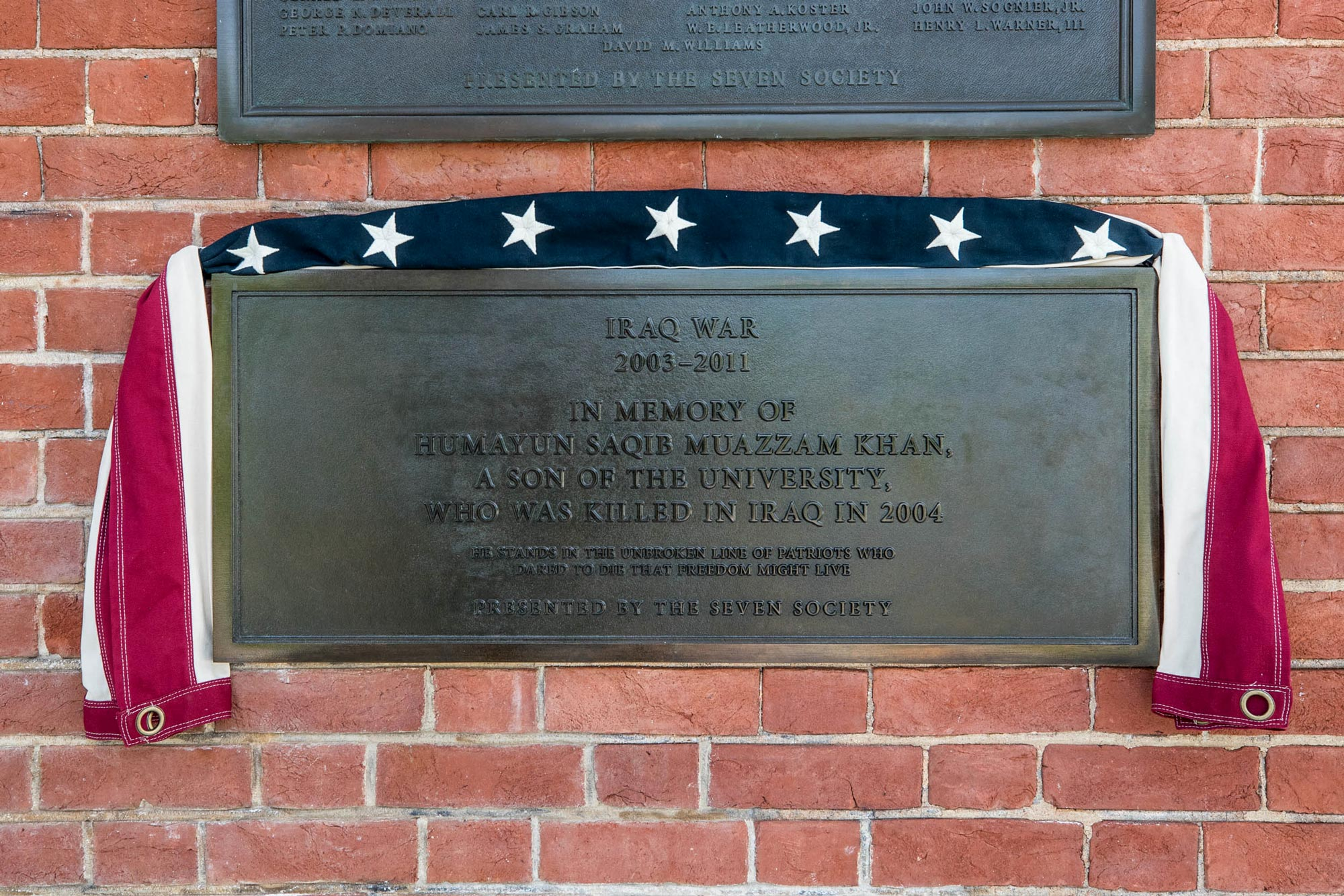 The plaque honoring Khan joins others on the Rotunda wall placed in memory of UVA graduates who fell in other wars.