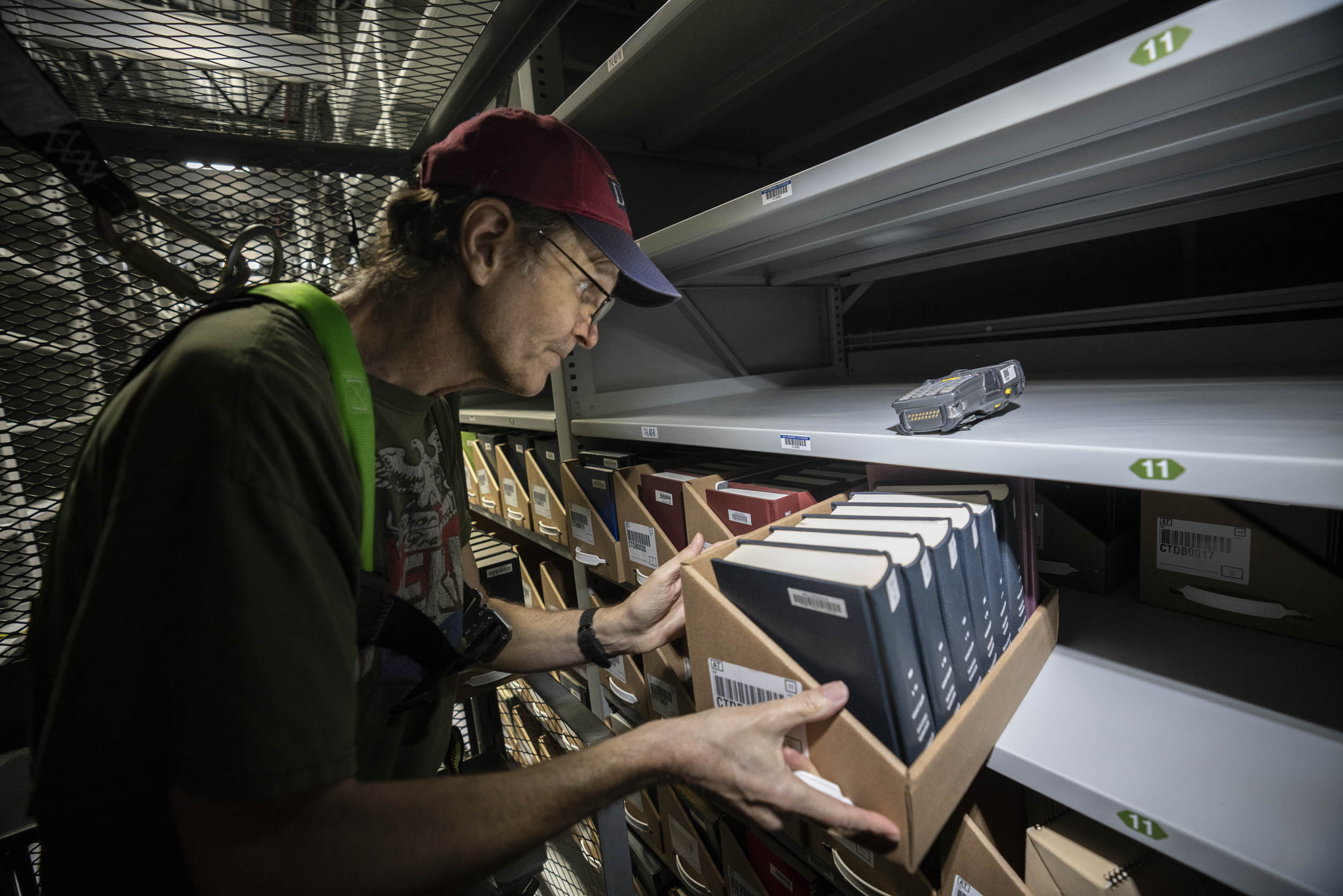 Steve Bartlett, the stacks manager, moves trays of books.