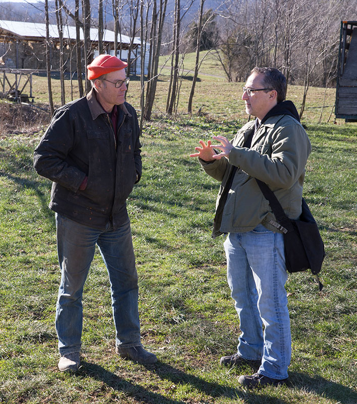 Joel Salatin (left) and University of Virginia politics professor Paul Freedman discuss the present course of agriculture at Salatin's base of operations, Polyface Farm in Swope. Freedman brought his Politics of Food January Term class to Polyface recentl