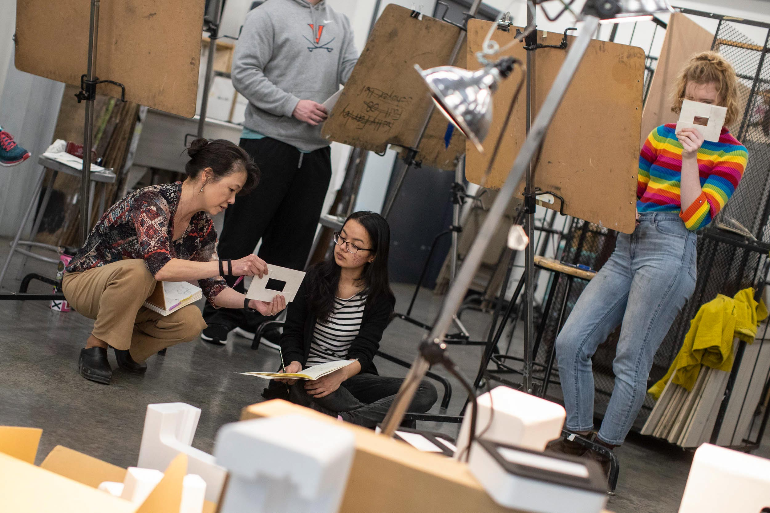 Studio art professor Akemi Ohira Rollando talks with second-year student Navashree Singh during her drawing class.