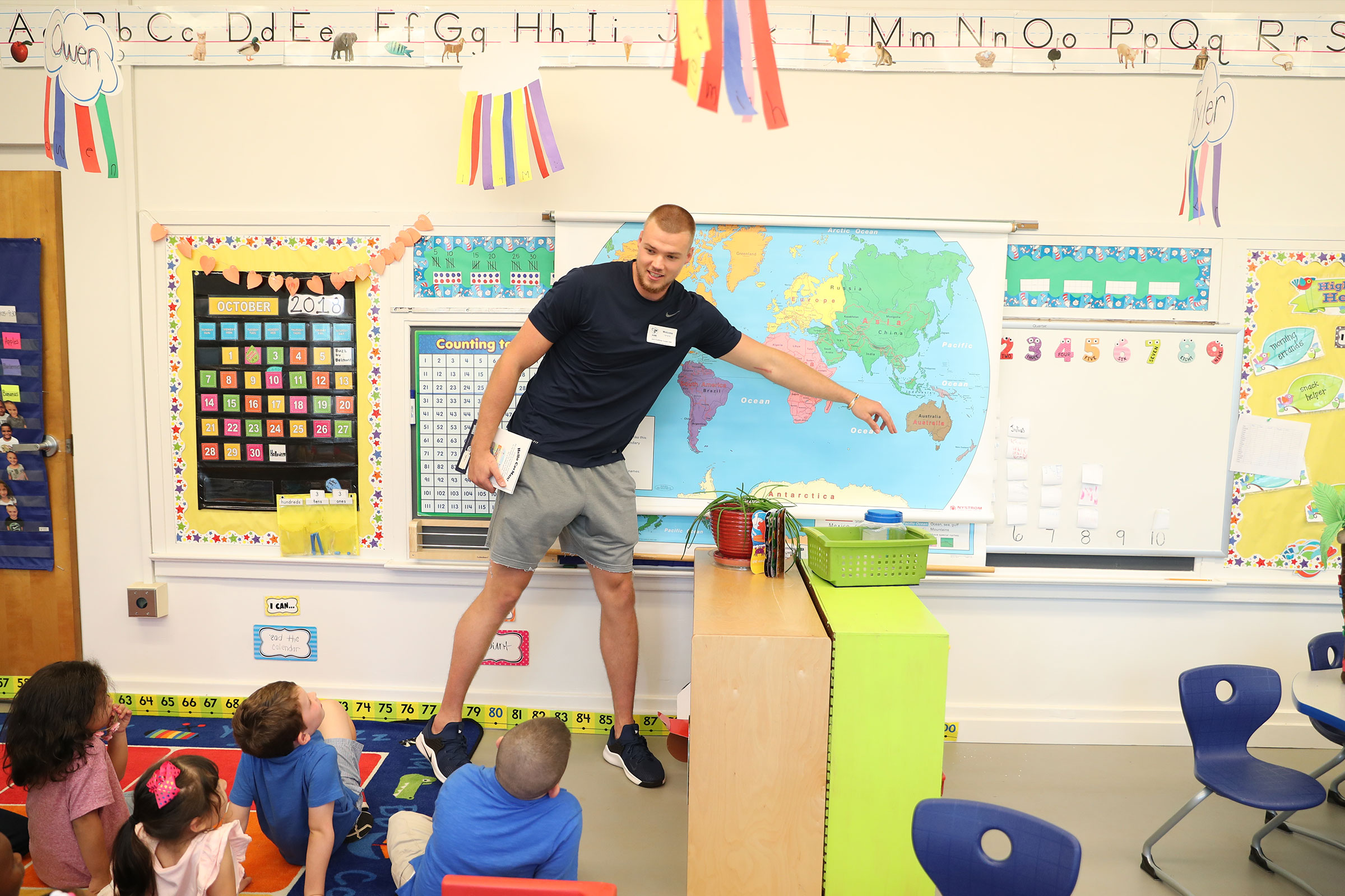 UVA men's basketball center Jack Salt tells Clark Elementary School kindergarteners about his home in New Zealand.