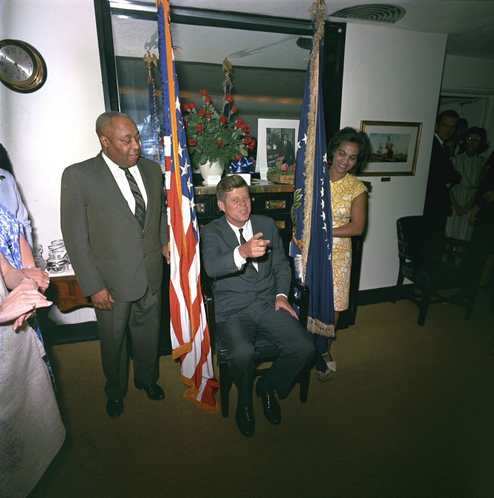 "Thomas, left, with President Kennedy and the first lady's personal assistant, Providencia ""Provi"" Paredes, at a surprise birthday party for the president."