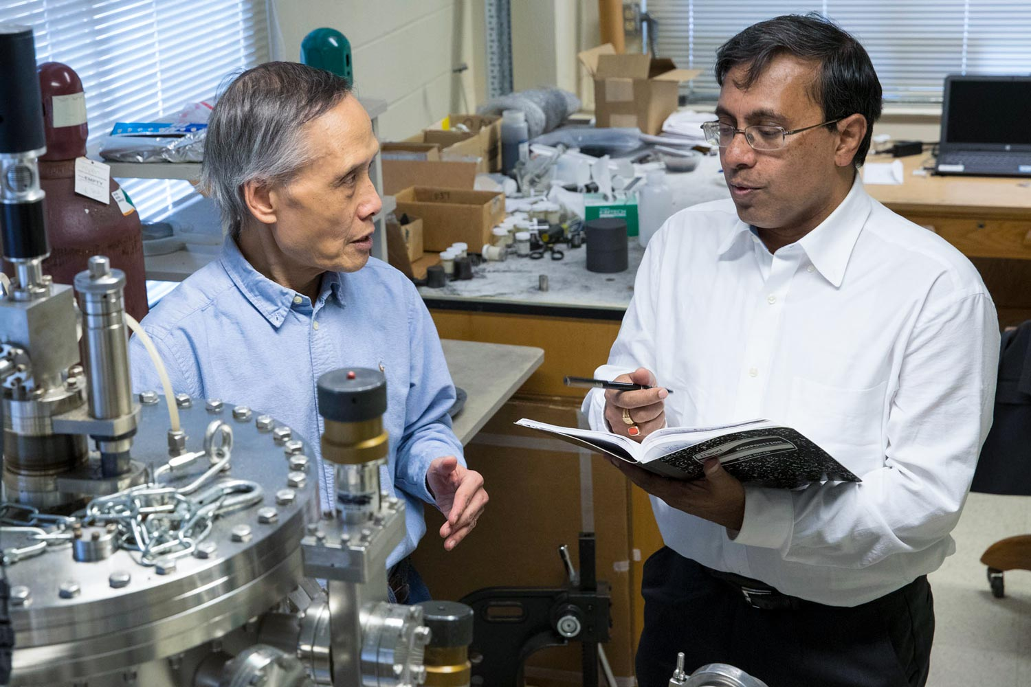 Joseph Poon, left, chair of the Department of Physics, and Avik Ghosh, a professor in the Department of Electrical and Computer Engineering and Department of Physics, discuss how to create skyrmions.