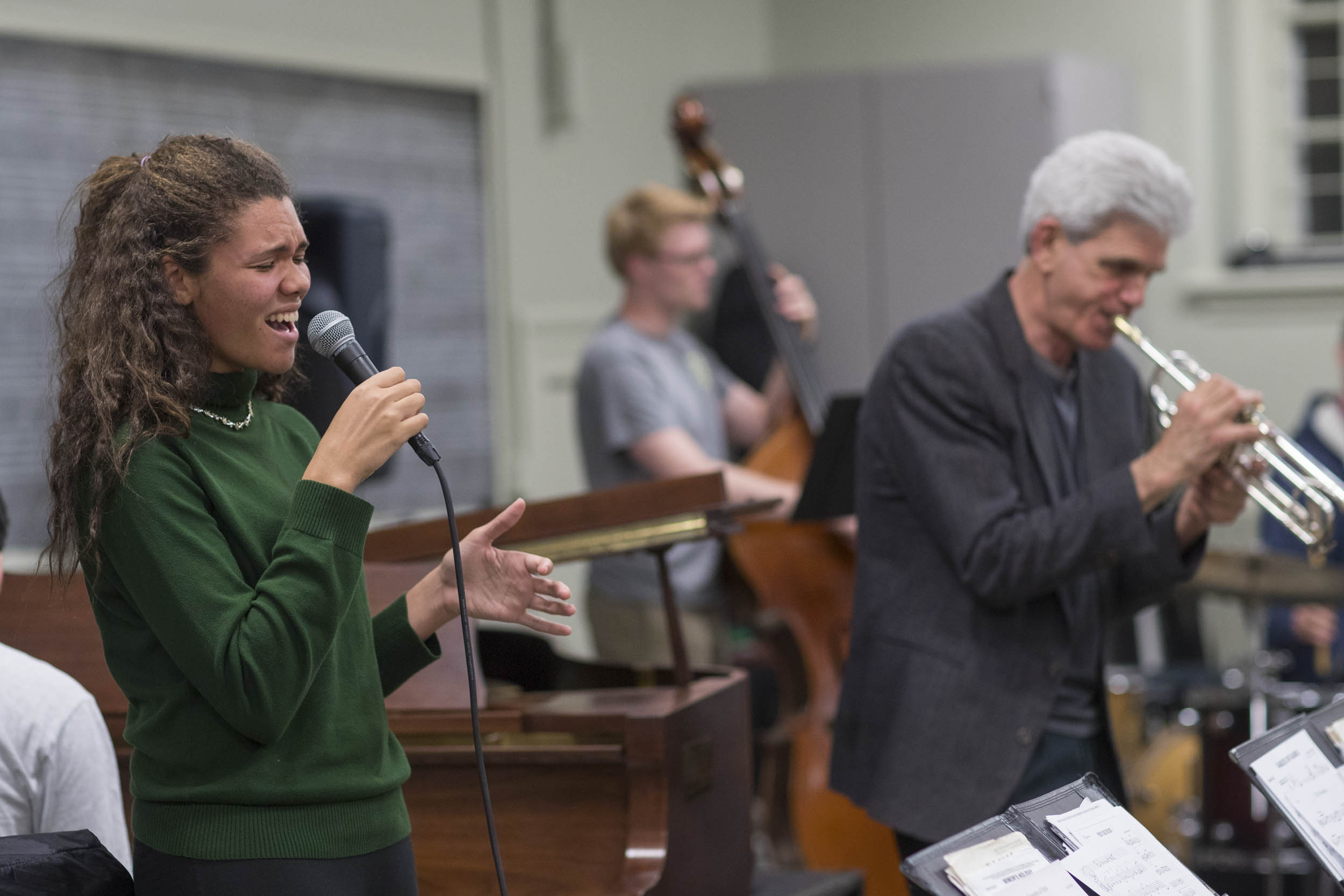 Second-year student Joy Collins, left, was a guest vocalist with the ensemble during Thursday's Facebook Live performance.