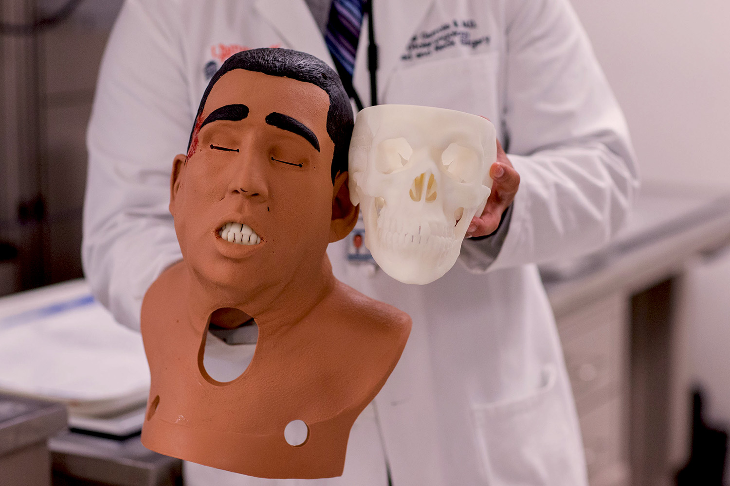 A facial mask is placed over the skull models to make them more closely resemble a live patient.