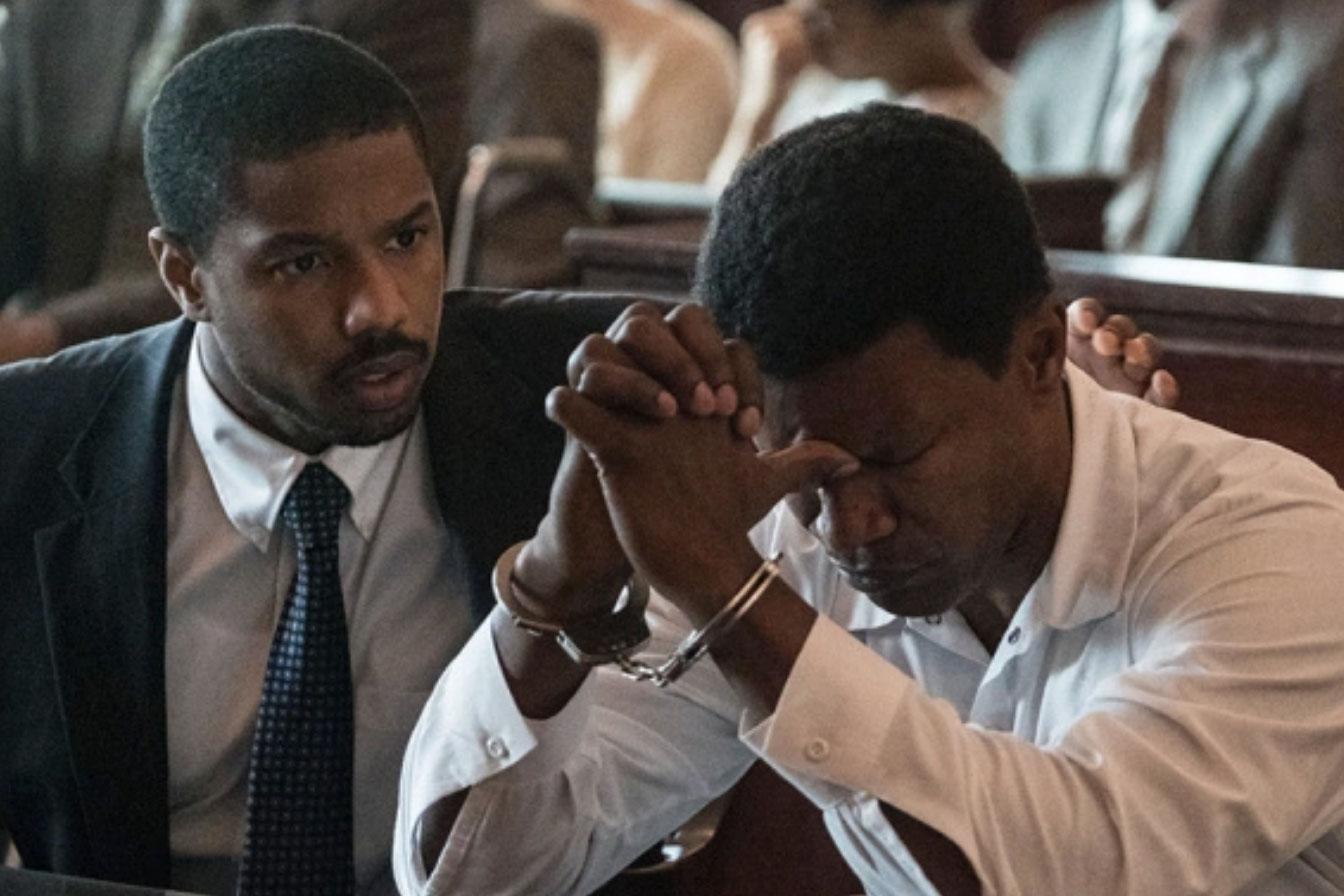 "Michael B. Jordan, left, plays Stevenson in ""Just Mercy"" alongside Jamie Foxx as Walter McMillian. (Image: Virginia Film Festival)"