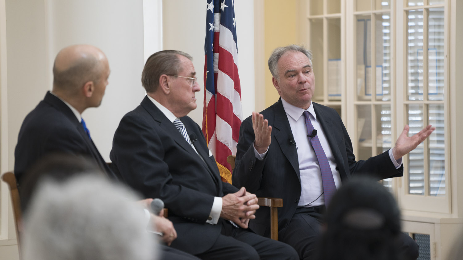 Kaine, right – joined by Miller Center Executive Director William Antholis, left, and UVA law professor John Jeffries – lauded the Miller Center's work in studying presidential war powers.