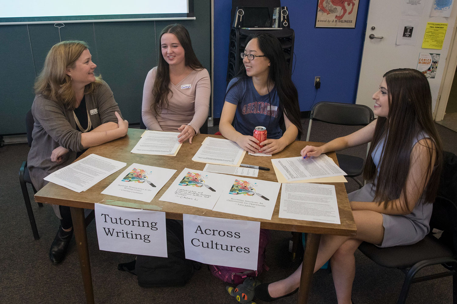 Kate Kostelnik, left, who teaches in the Academic and Professional Writing Program, brought students Courtny Cushman, Chelsea Li and Lara Jabbour to a showcase on community engagement and writing.
