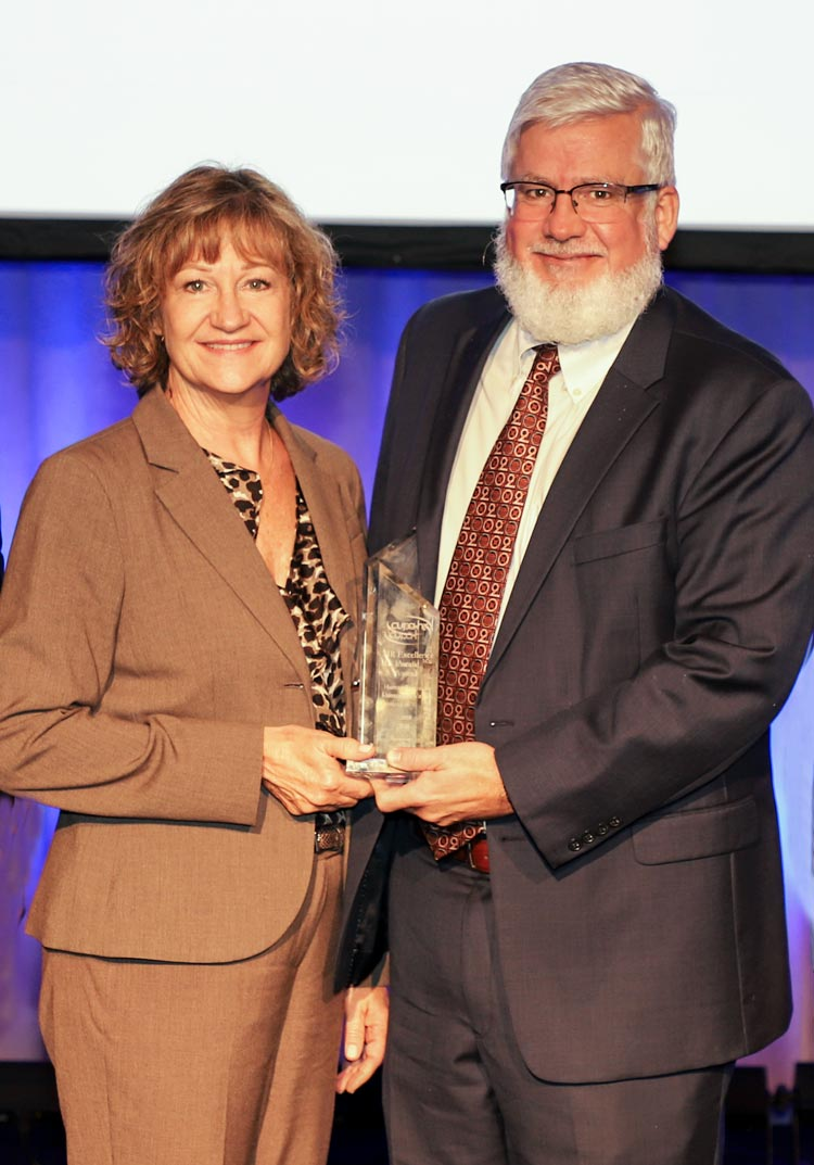 Vice President and Chief Human Resources Officer Kelley Stuck and UFirst Project Executive Director Sean Jackson with the national award.