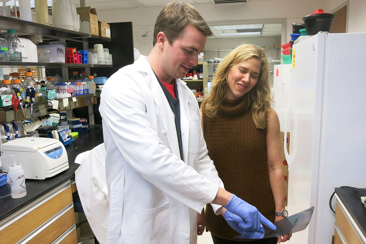 Melissa Kendall of UVA's Department of Microbiology, Immunology and Cancer Biology, right, and graduate student Christopher J. Anderson.