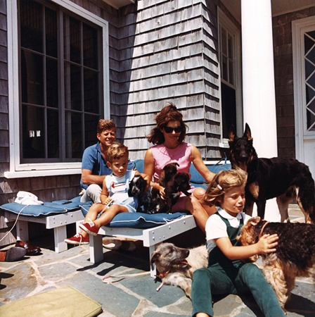 The four Kennedys with their family dogs and the two puppies from Khrushchev, in Jackie's lap.