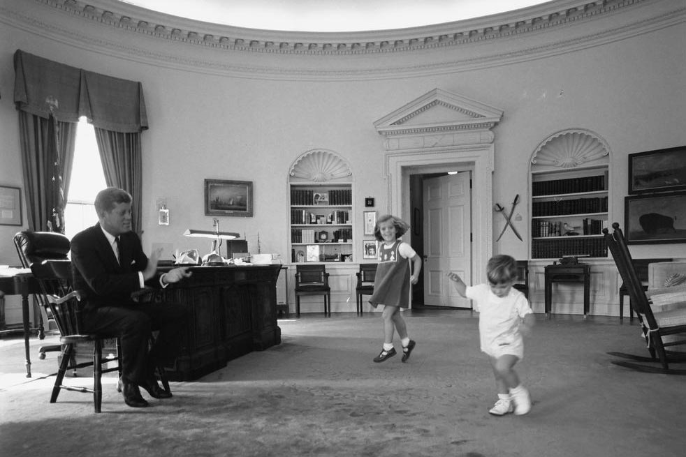 Kennedy with Caroline and John Jr. in the Oval Office in 1962.