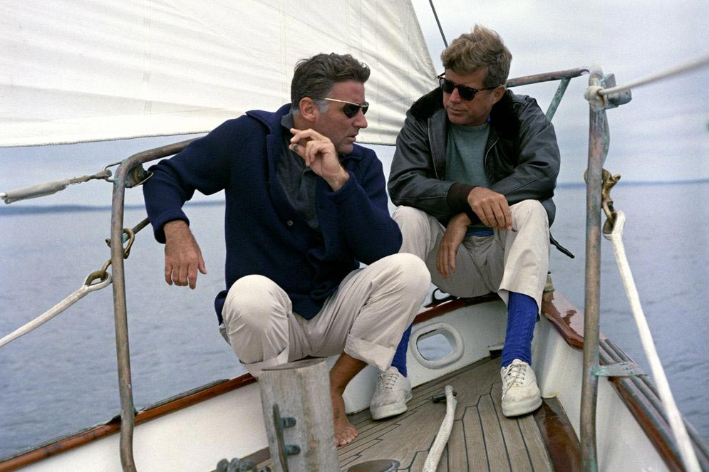 The president, right, with brother-in-law Peter Lawford on a U.S. Coast Guard yacht.