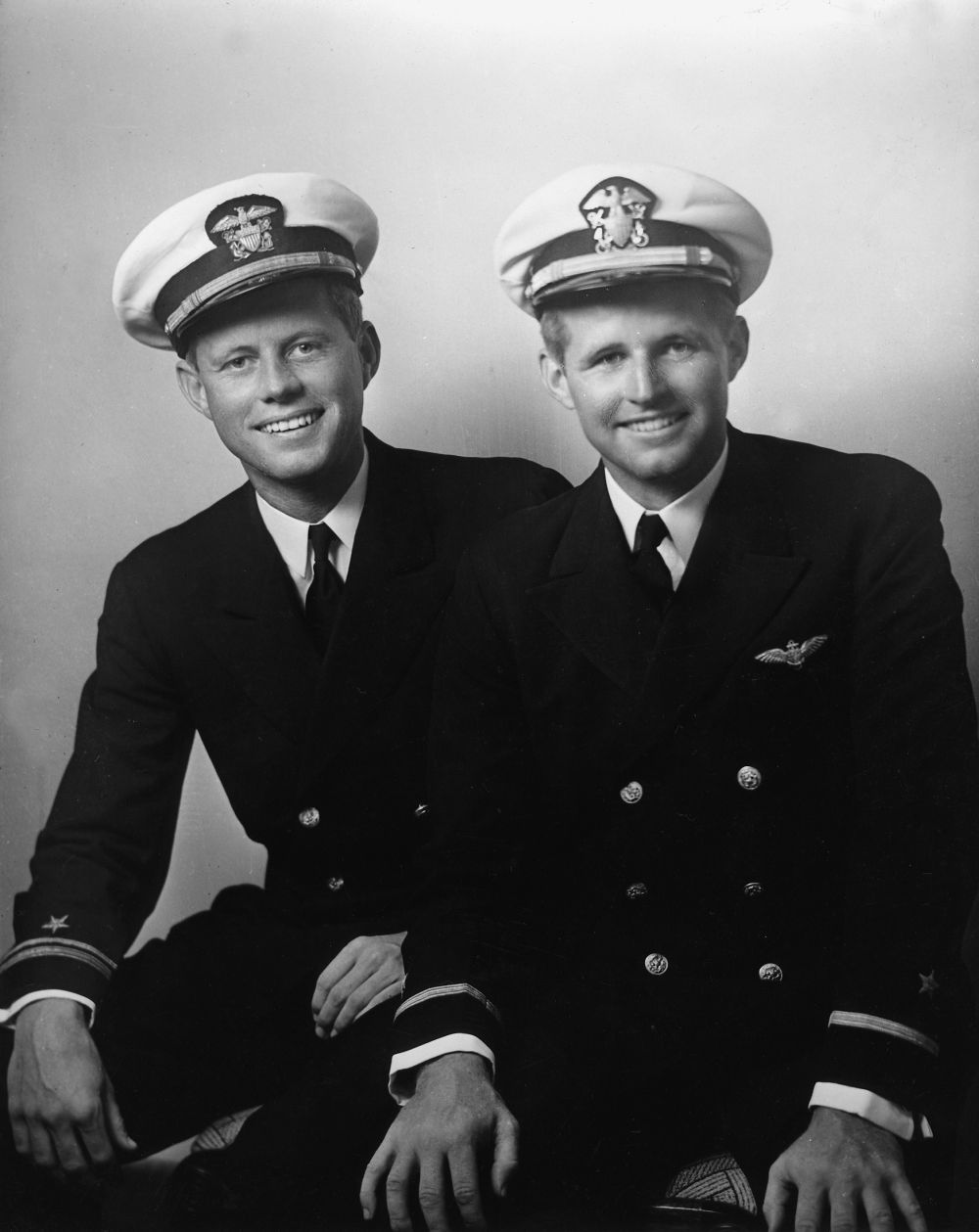 John F. Kennedy, left, with his older brother, Joseph P. Kennedy Jr., in 1942. JFK fought in the Pacific, while Joe Kennedy Jr. flew over Europe.