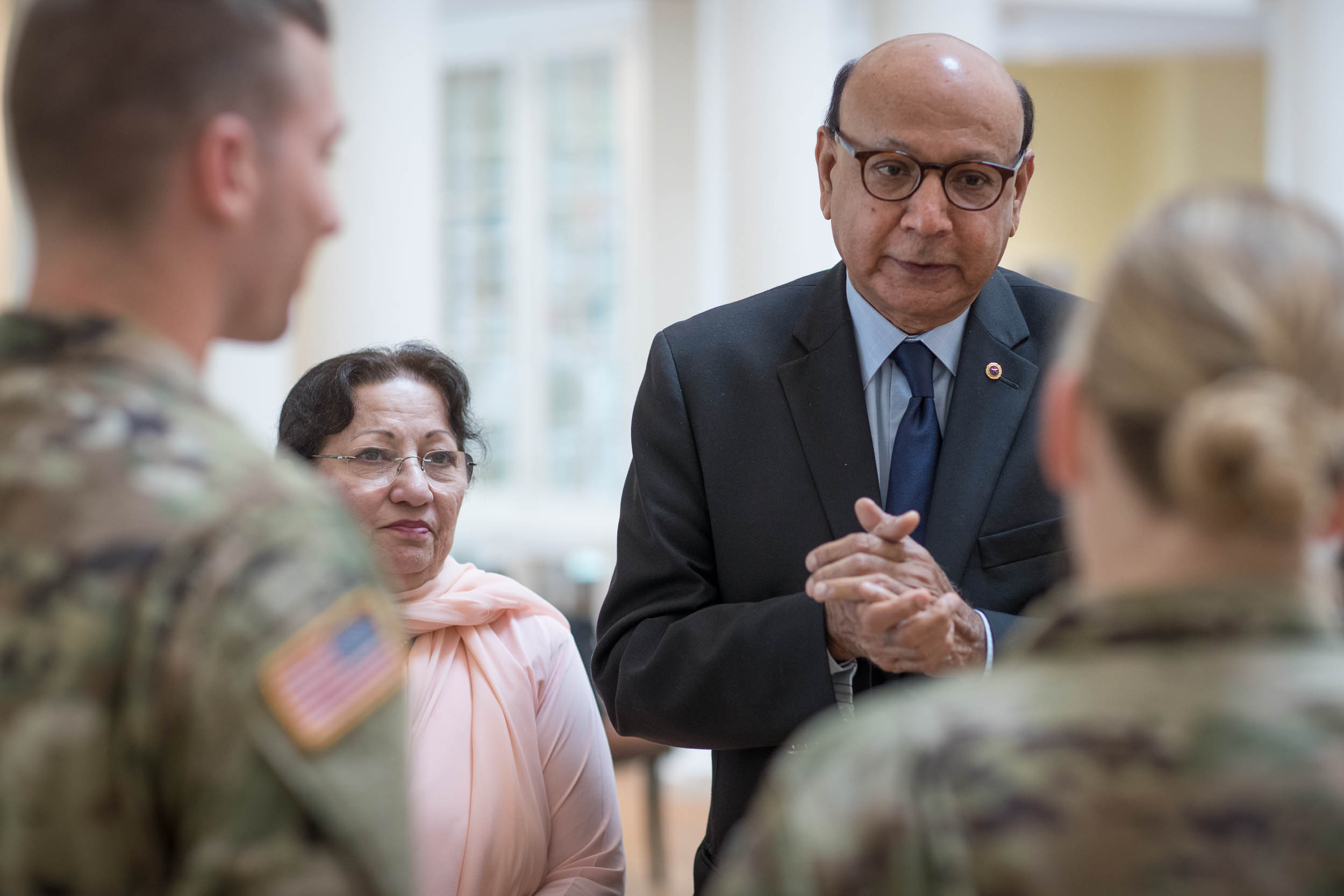 Khizr and Ghazala Khan met with U.S. Army 2nd Lt. Christopher Bayer, left, and U.S. Army Capt. Jane A. Petrick on Friday.