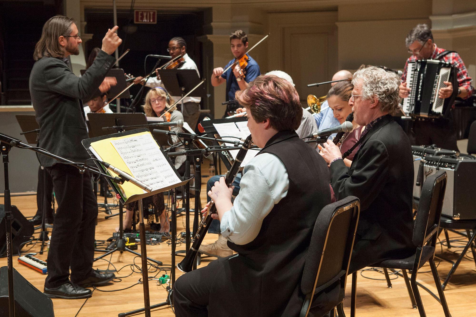 Shneyveys, left, leads the ensemble during Thursday's concert.