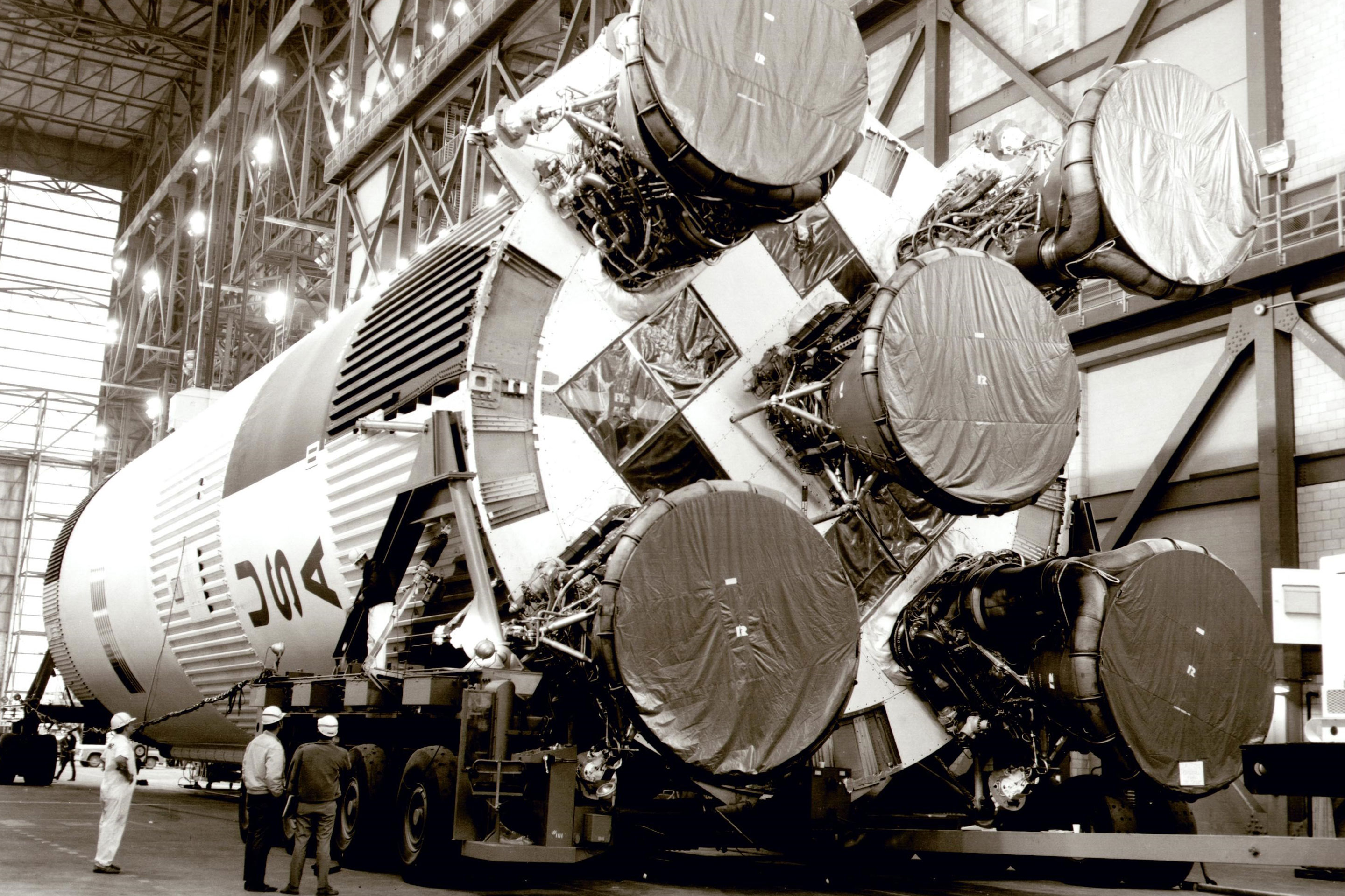 The Saturn V rocket is lifted onto its mobile launcher in the Vehicle Assembly Building at Kennedy Space Center in 1969.