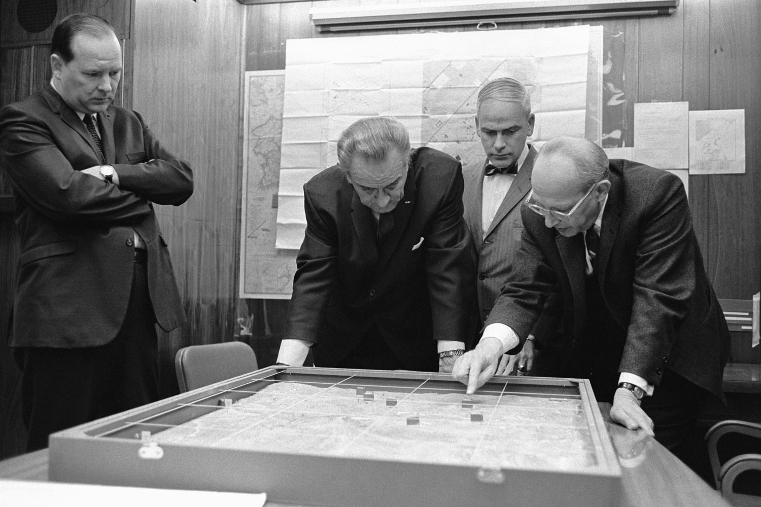 Special Assistant for National Security Affairs Walt Rostow shows President Lyndon Johnson a model of the Khe Sanh area on Feb. 15, 1968.