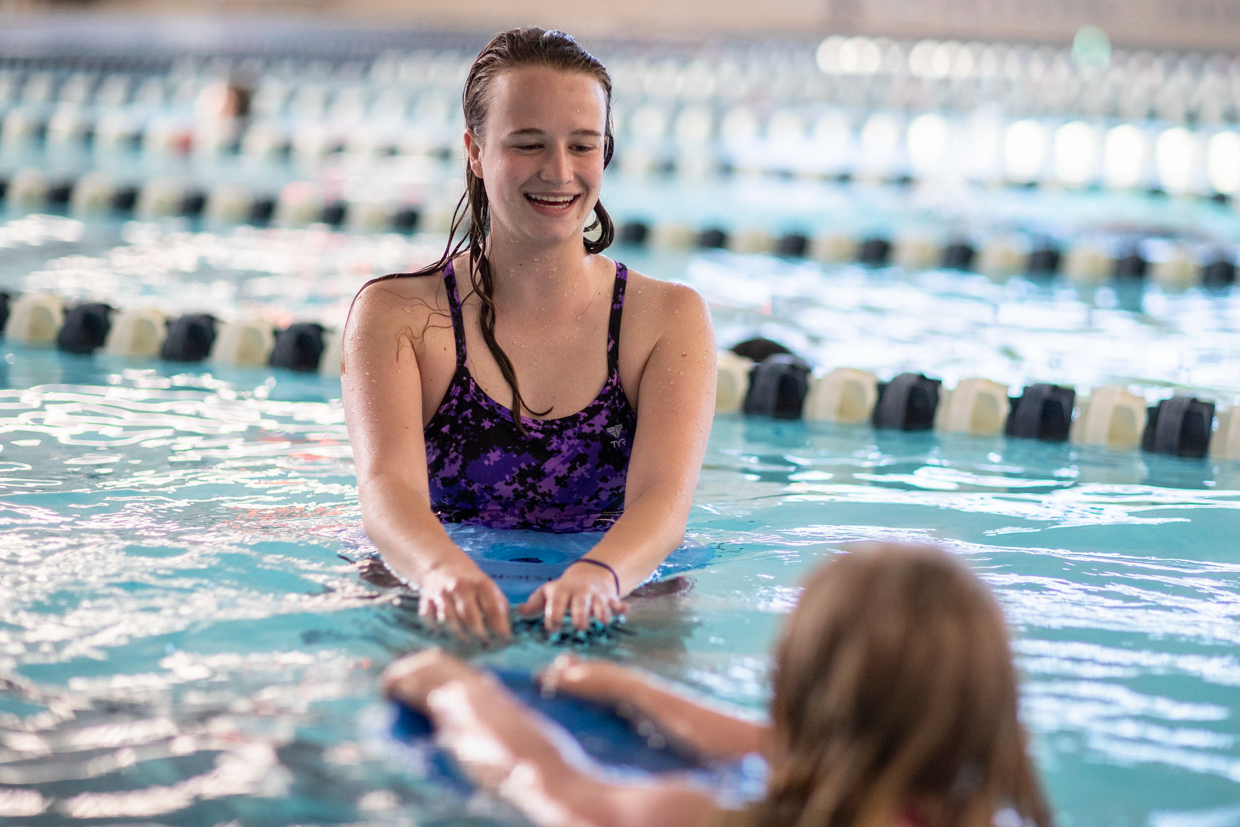 Neal helps at a Special Olympics swim practice.