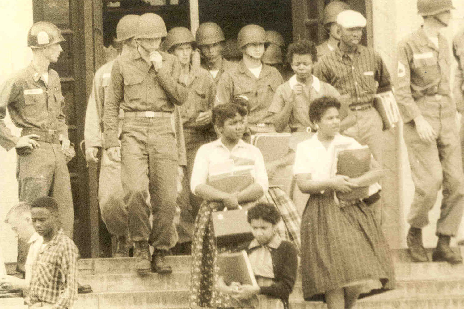"""One of Mims' favorite books is """"Warriors Don't Cry,"""" by Melba Pattillo Beals (with lunch box), one of the famed """"Little Rock Nine."""""""