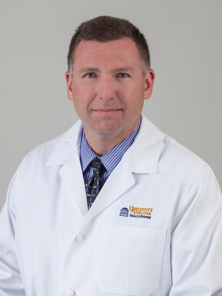 Dr. John MacKnight is the co-medical director for sports medicine at UVA and the primary care team physician.