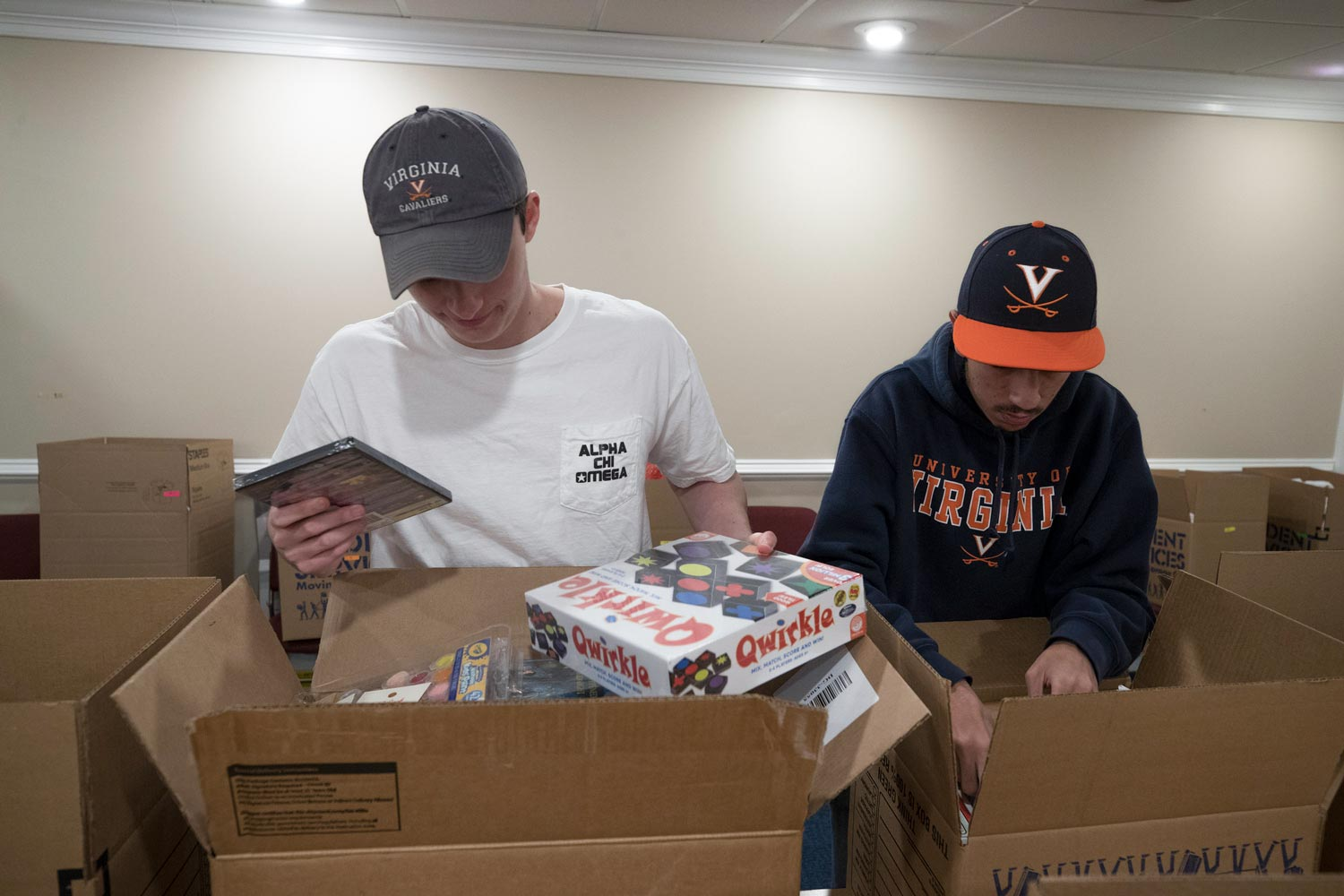 Student volunteers Andrew Rehr, left, and Michael Bassilios prepare packages for the Madison House Holiday Sharing program.