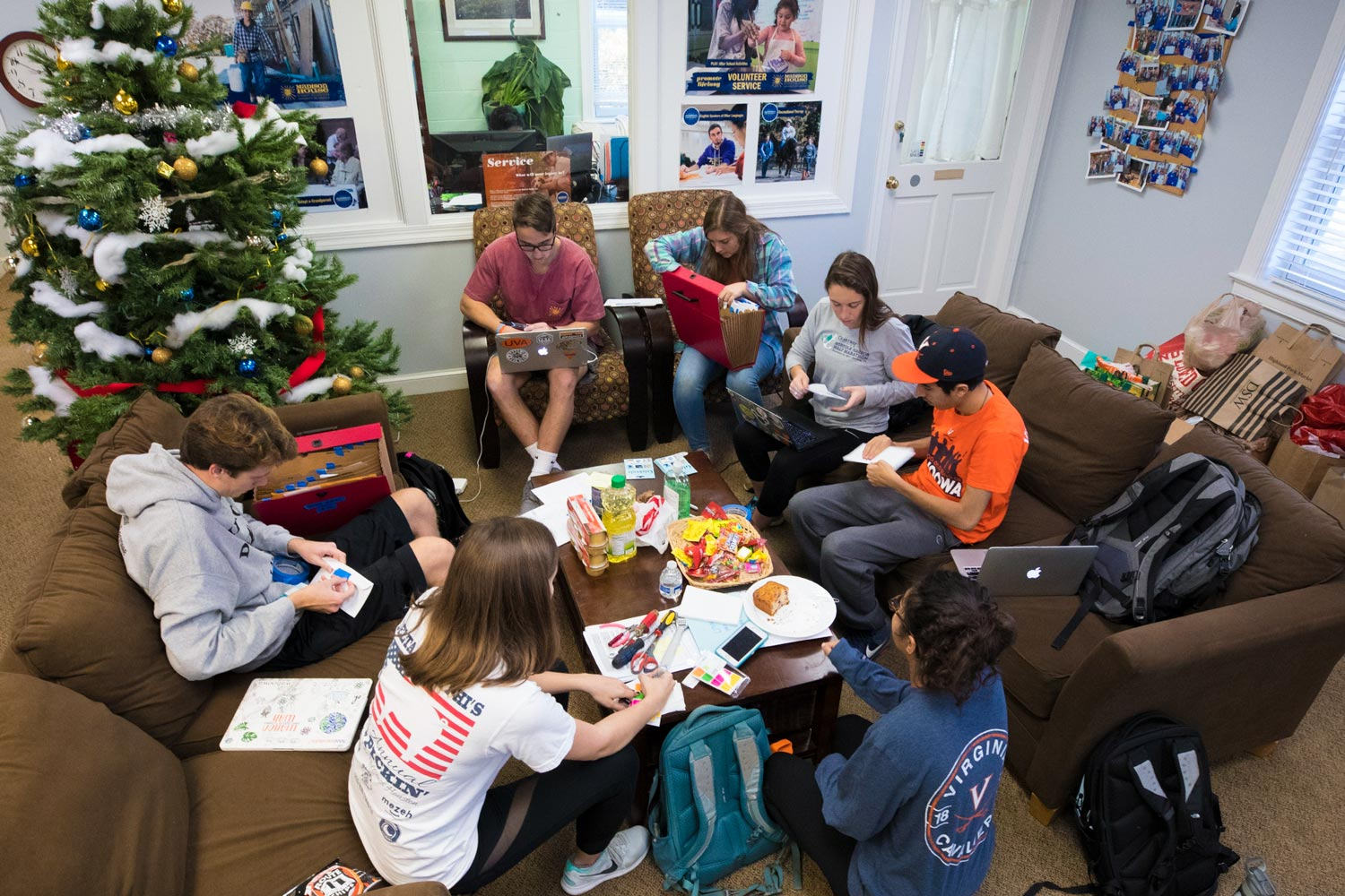Madison House student volunteers, from left on couch, clockwise: Ally Bollettino, Bryce Griffin, Cameron Walker, Carla Weidner, Meredith Hughes, Michael Bassilios and Salwa Malik.
