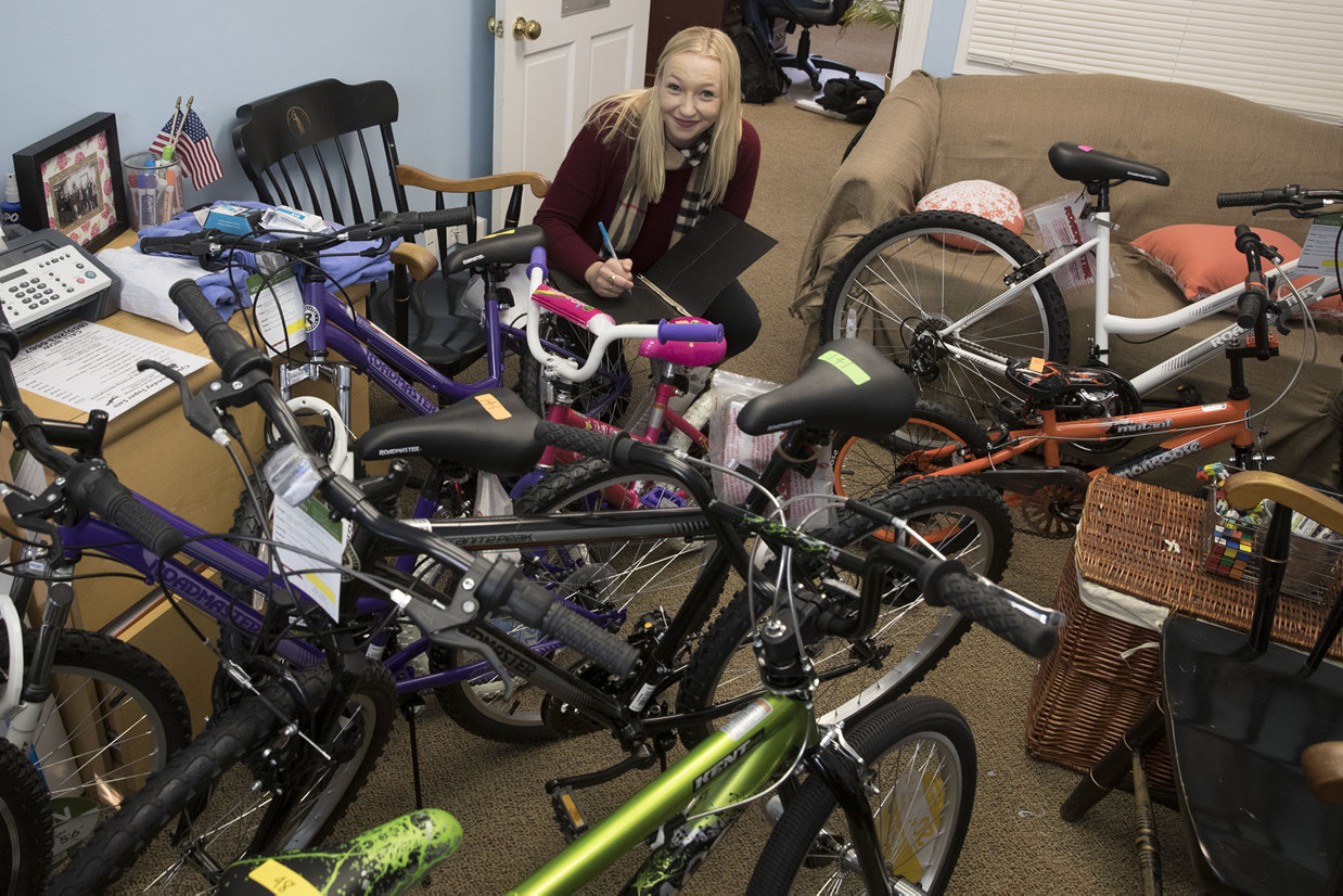 Bikes, bikes and more bikes! As the Holiday Sharing program head program director, fourth-year student Emily Brown oversees about 50 Madison House volunteers and helps inventory donations.
