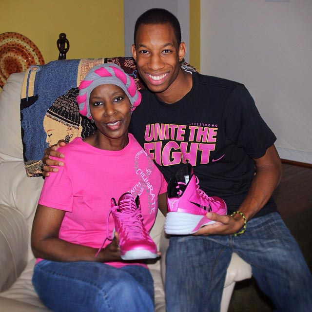 Malcolm Stewart and his mother, Loraine, in 2013. Stewart bought his pink basketball shoes after his mother's diagnosis. He still squeezes into the shoes to play, even though he has outgrown them.