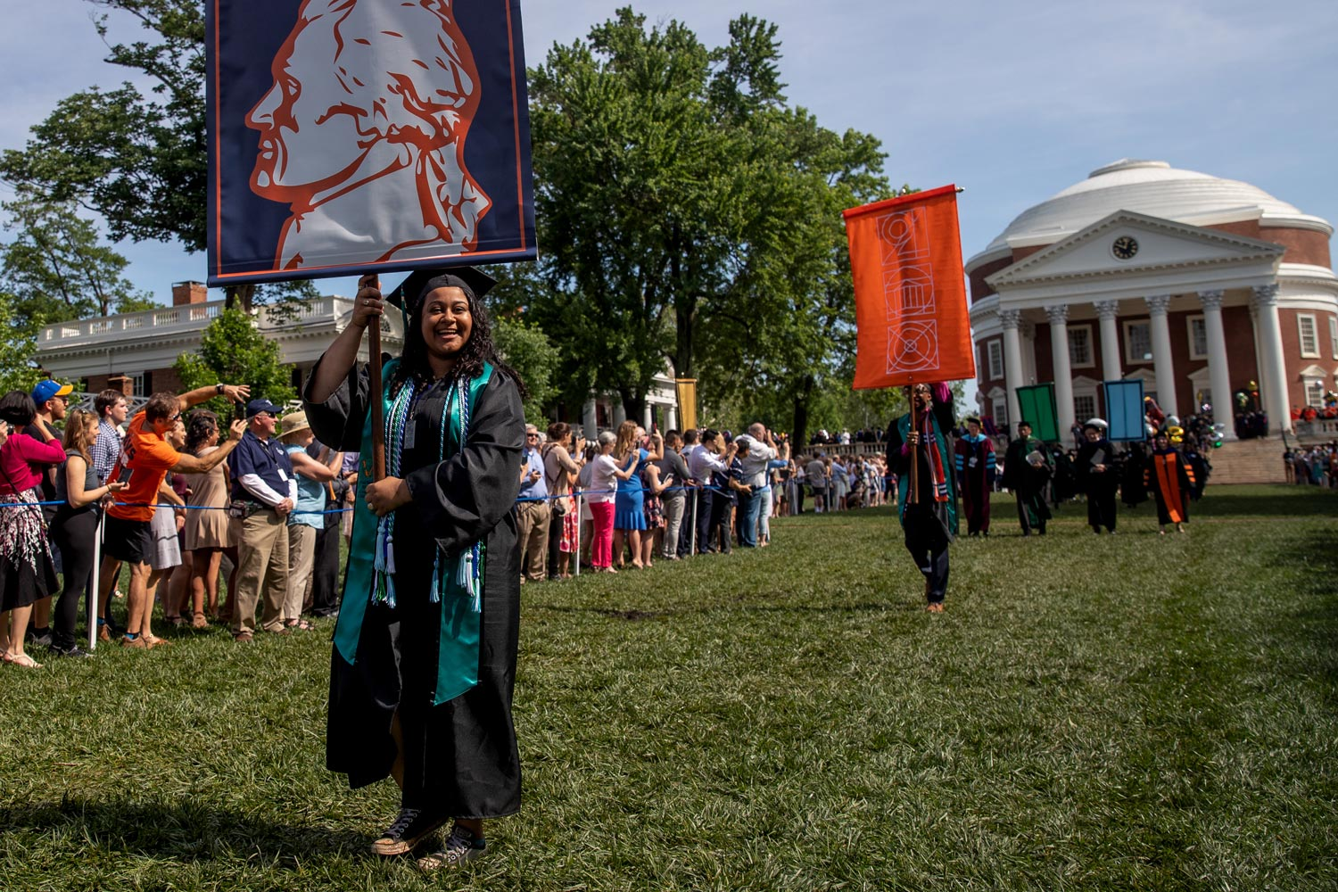 Diane D'Costa and Malcolm Stewart, leaders of the Class of 2018, walk down the Lawn during Final Exercises.