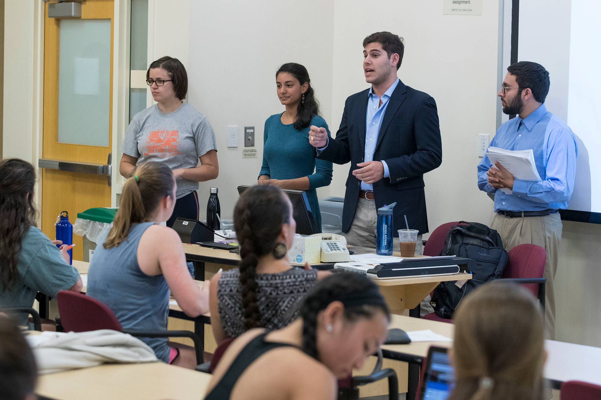 Sabhi Singh and Marc Blatt, second and third from the left, tailored their EMS medical Spanish course to nursing students and offered it during two packed sessions in April. (Photo by Dan Addison, University Communications)