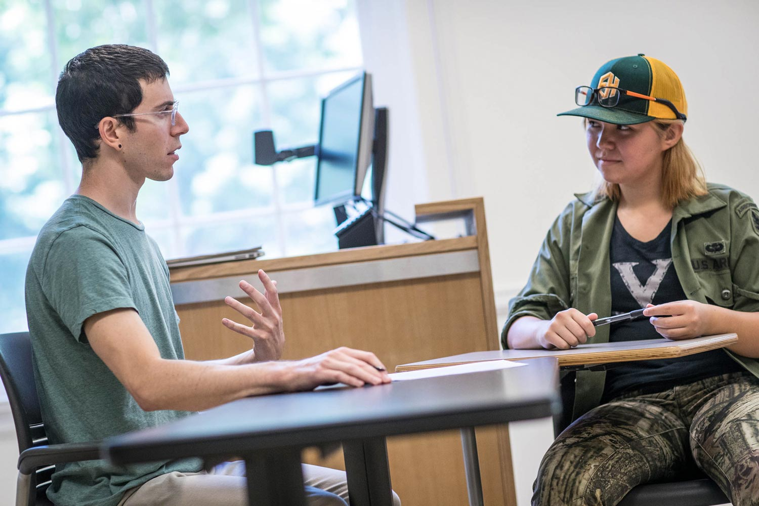 "Matthew Andler, a doctoral student in philosophy who taught a summer course on ""Masculinity,"" talked with Sardana Coyle, a rising second-year student from Mathias, West Virginia after class."