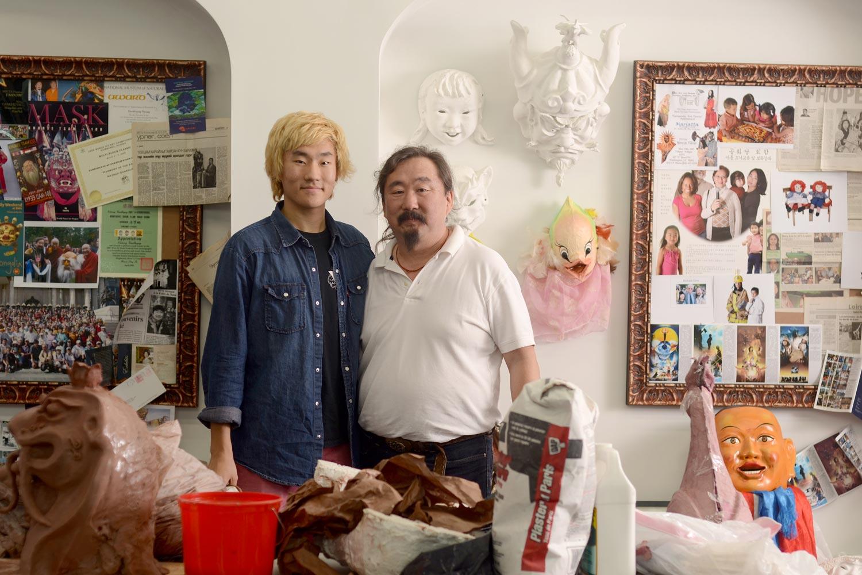 "Mongolian mask-making master ""Gankhuyag ""Ganna"" Natsag stands with his folklife apprentice, Zanabazar Gankhuyag."