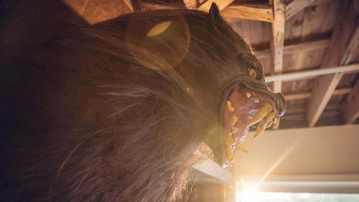 A werewolf mask mounted on a wall