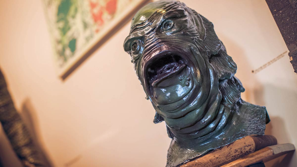 A gill-man mask on a pedestal