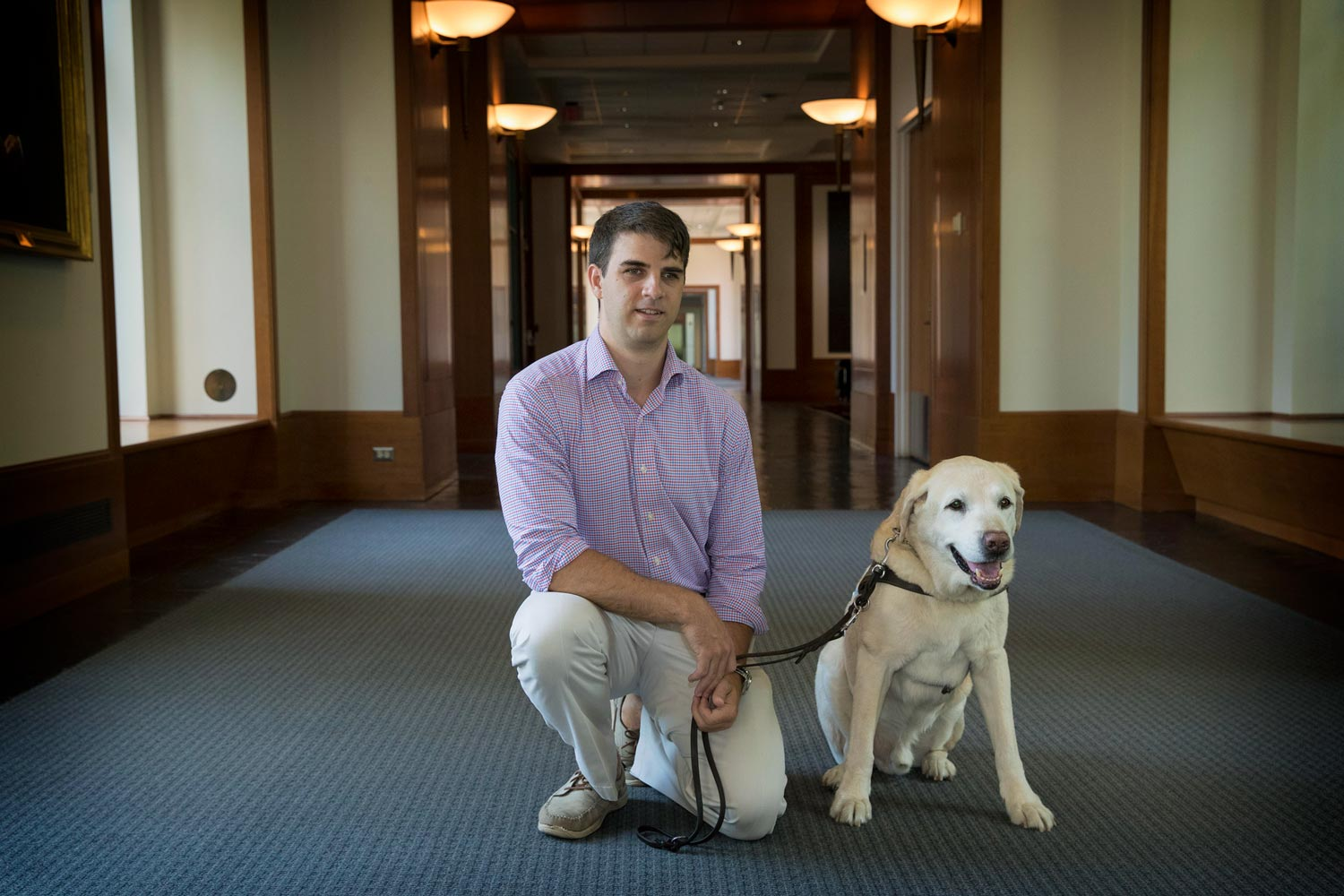 Simpson (pictured with his guide dog, Lacrosse) hopes to become an advocate for the blind after he graduates.