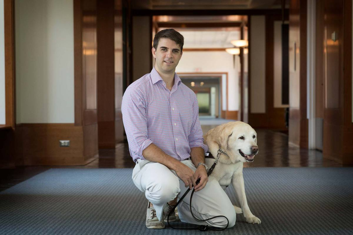 Simpson's guide dog, Lacrosse, died in the fall. Lacrosse was a popular member of the Law School Class of 2020, taking home the top prize in the school's annual Paw Review. (Photo by Dan Addison, University Communications)