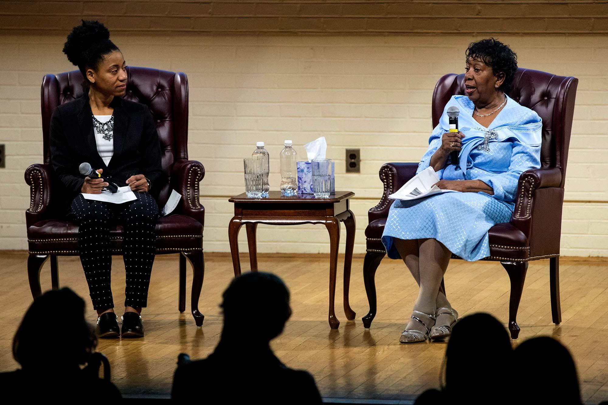Nursing doctoral student Tori Tucker interviews Mavis Claytor during Friday's event at the Nursing School's McLeoad Auditorium.