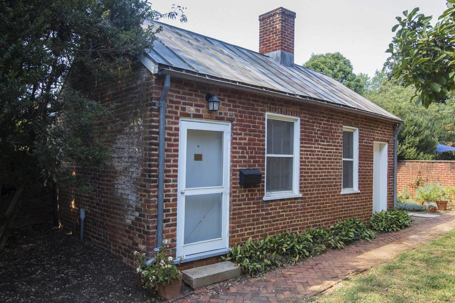 McGuffey Cottage, located to the west and back of Pavilion IX, originally housed enslaved workers.