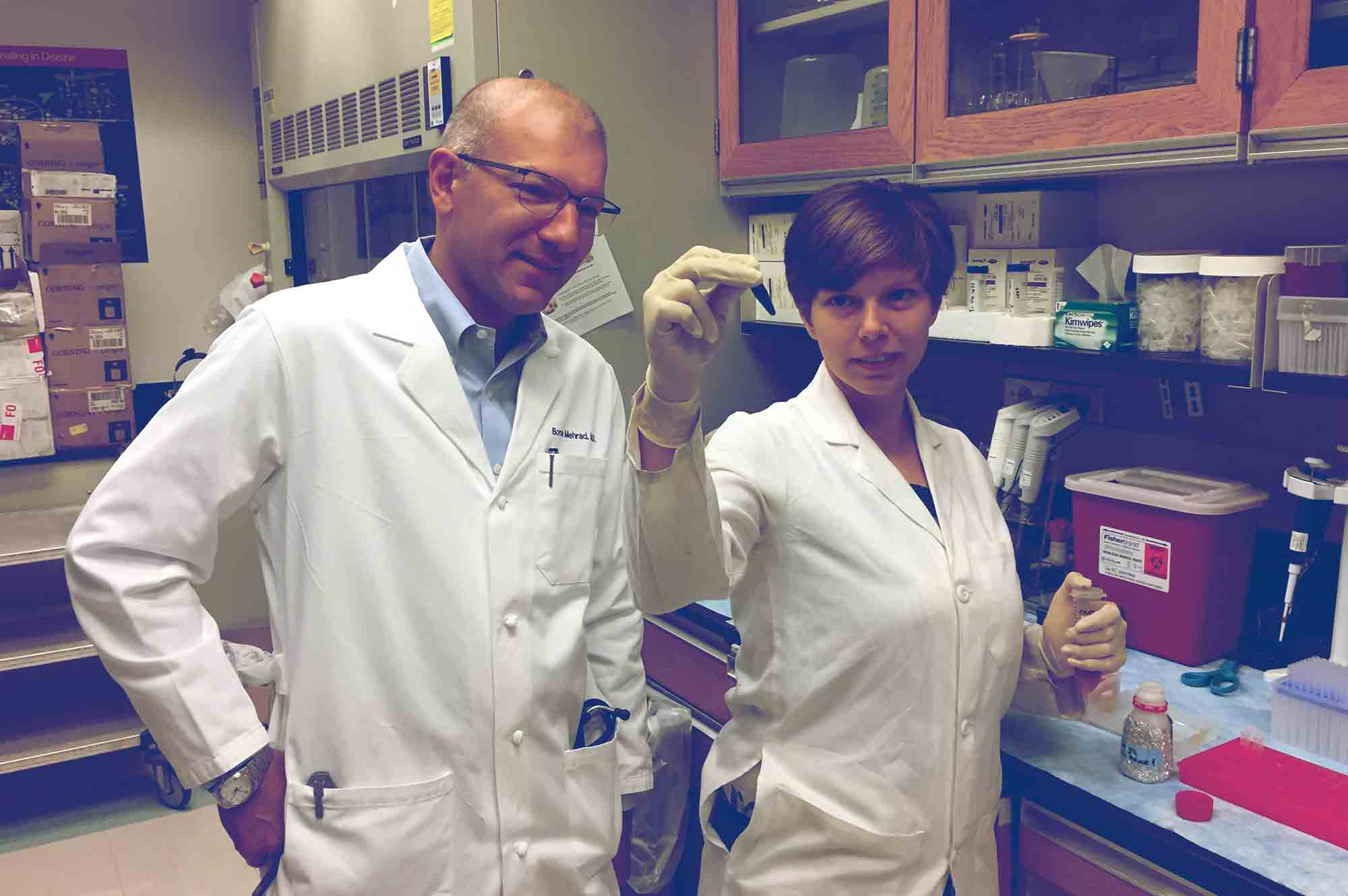 UVA researchers Borna Mehrad, left, and Kathryn Michels found that the hormone hepcidin limits the spread of the pneumonia bacteria by hiding the iron in the blood that the bacteria need to survive and grow.