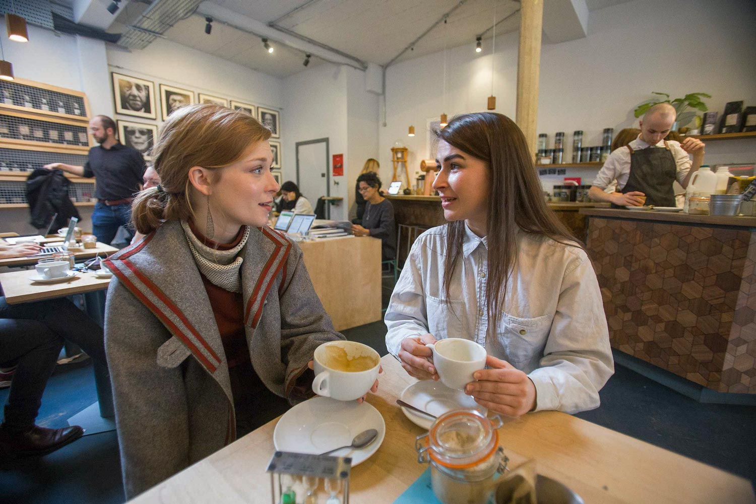 Cox, right, with her friend and fellow art historian, University of North Carolina graduate Meredith Miller, at Society Café, one of their favorite coffee shops in Oxford.