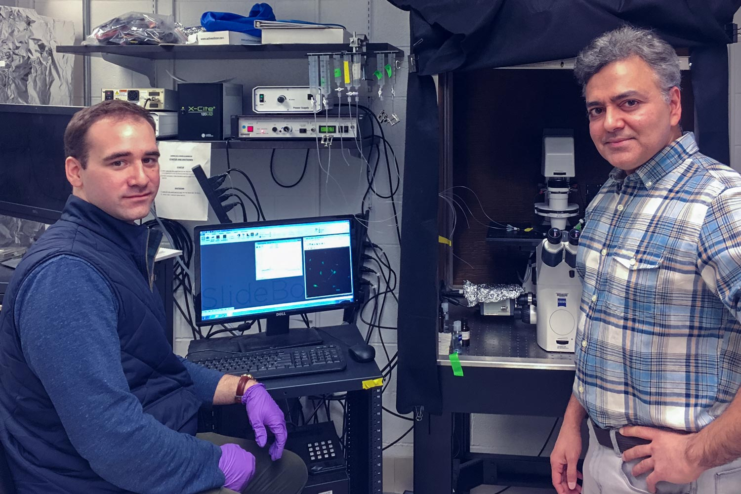 Researchers Michael Schappe, left, and Bimal Desai of UVA's School of Medicine may have found an end run around one barrier that has prevented effective treatment for neurodegenerative diseases.