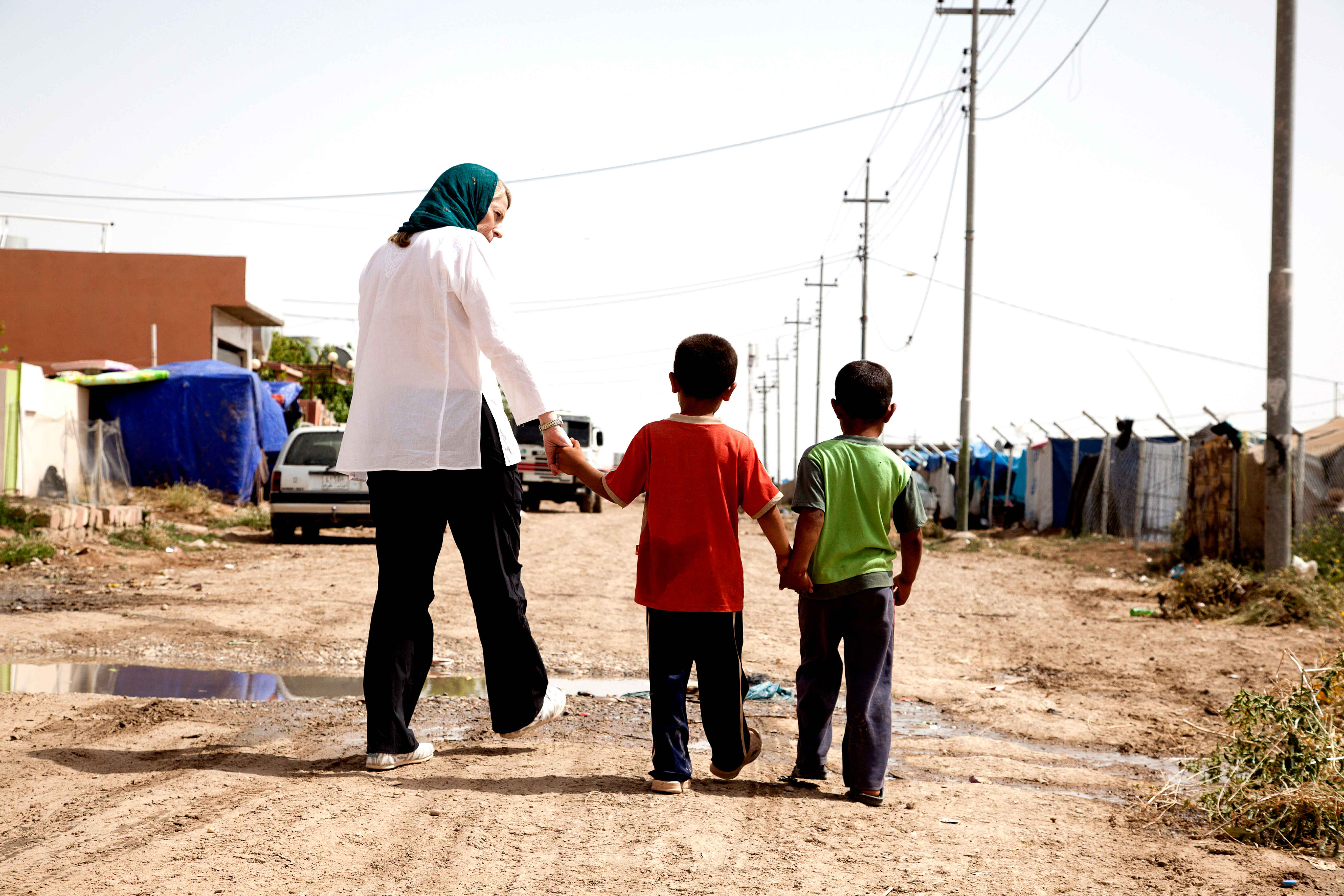 Above, Miles visits a refugee camp in Northern Iraq, home to many refugees fleeing violence in Syria. (Photo courtesy of Save the Children)
