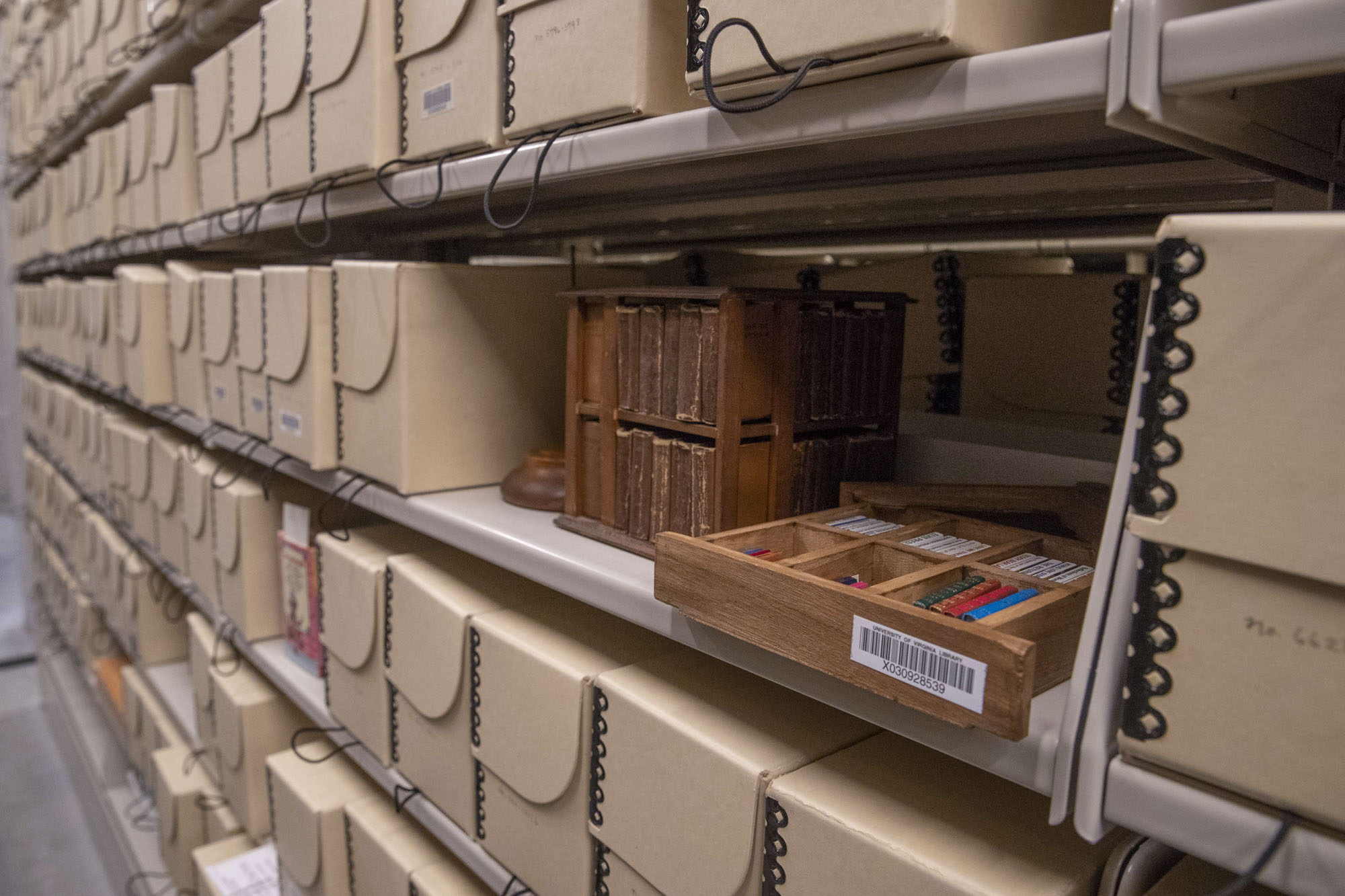 The 15,000 volumes of the McGehee Miniature Book Collection are stored in microfilm boxes and occupy just two sides of compact shelves in the rare book archives.