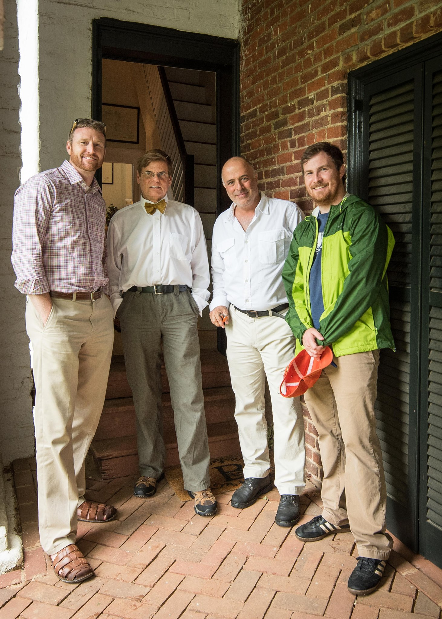 Director of Studies Stephen Plaskon, second from left, and Montes-Bradley, third from left, invited U.Va. Associate Professor of Architectural History Louis Nelson, left, and graduate assistant Kyle Edwards, right, to tour the small building.