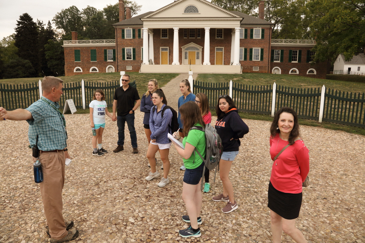 As part of a course on teaching social studies in elementary school, a group of Curry School master's students begins their tour of James and Dolley Madison's plantation home.