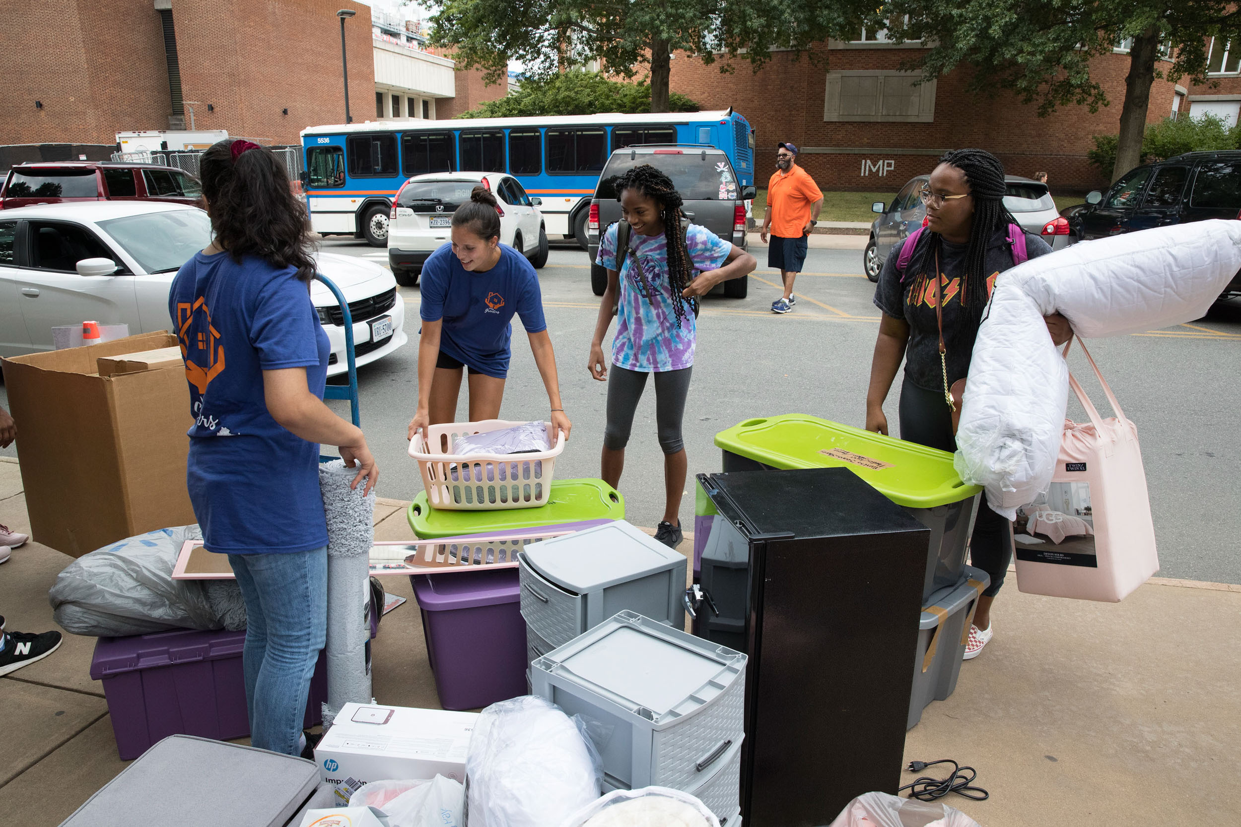 Taylor Gibson, far right, stands amid two carloads of belongings she hopes to fit into her room in Emmet. Her mother, Lisa, said she was prepared to have to bring some of her daughter's things back to their Chesterfield home.